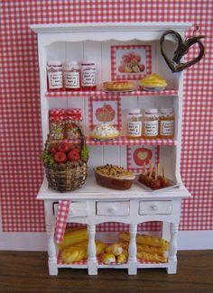 Apple Cottage Kitchen hutch dressed,  Twelfh scale dollhouse miniature. $38.50, via Etsy.
