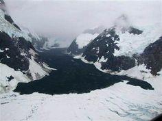 Image: Rock and debris from a landslide lie along five miles of what had been an ice-white glacier inside Glacier Bay National Park.