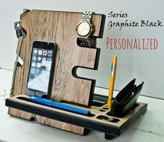 This docking station is compatible with all cell phones including iPhone 6 plus, iPhone 6, iPhone 5, iPhone 4, and Android phones. Docking Station was created so that you can keep several things at one place: cell phone, wallet, watch, keys, jewelry, accessories, pens and other small items. There is a nest where you can hang. keychain, bracelets, necklaces. With our Station you can simultaneously charge the phone and work with it, as for charging there is a special slot. Wood: Oak…