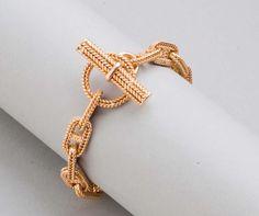 Hermès - Chaine d'ancre tressé - or jaune, fermeture bâtonnet