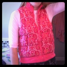 Reversible coral vest This vest can be worn with the paisley side out or the plain coral size out. The tag is cut out so i don't know the size, but I would guess a medium, maybe a small. I'm usually a medium and it fits me. Never worn, so it's in great condition! Jackets & Coats Vests