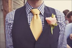 Love the plaid shirt! The groomsmen ties would alternate from yellow to red just like the bridesmaids shoes and accessories.  Dark wash jeans and dress shoes to complete the outfit