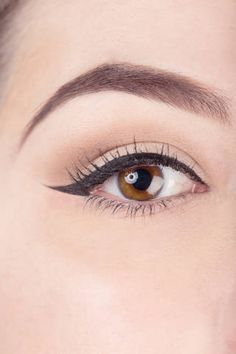 Notice how the liquid liner starts out slim, gradually widens as it moves along to the outer corner, and then flicks out to a sharp, straight point at the end.