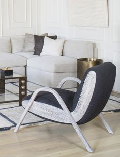 KELLY WEARSTLER | CAMDEN LOUNGE CHAIR. Relaxed low seat height in tight upholstery and coerced wood.