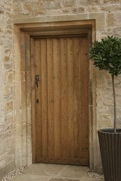MEDIEVAL STYLE OLD OAK HANDMADE DOOR  The oak frame was made with a specially shaped cross section, so it fitted around the existing stonework.