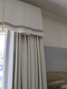 design indulgence - deep inverted pleats and decorative braid accent the valance while the panels carry matching braid down the leading edge