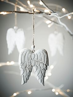 Angel wings - made from wood and finished in antiqued white.