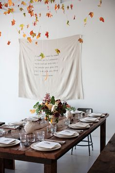 A beautiful fall table setting - I love the printed cloth banner on the wall | the style files