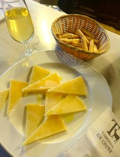Simple is sometimes best: slices of mature Manchego cheese drizzled in virgin olive oil with a glass of fino, Montilla, Spain