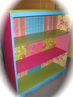 I just decoupaged the girls' bookshelf... turned out great! (Mine is not as bright as this one though!) :)