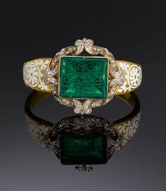 An inscribed Mughal emerald personal seal set in a diamond encrusted gold bangle and bearing the name of Major Alexander Hannay, an East India Company officer