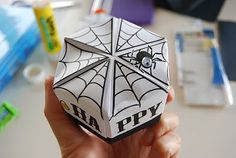 printable halloween origami box and tutorial (could be adapted to make chocolate. printable halloween origami box and tutorial (could be adapted to make chocolate frog boxes) Halloween Boo, Halloween Candy, Origami Halloween, Halloween Ideas, Origami Box, Origami Paper, Chocolate Frog, Arts And Crafts, Paper Crafts
