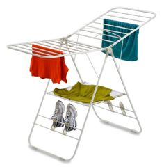 Indoor folding clothes drying rack. Wing height adjustable to accomodate long and short garments, mesh shelf for drying sweaters, shoe drying hooks, folds down to 3.5 inches to save space.