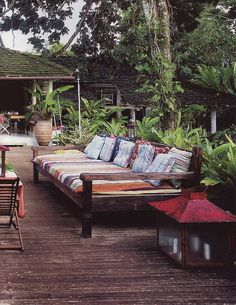 Deep seated wood bench cushioned outdoor deck lanterns foliage via:Home isnt a place its a feeling! Outdoor Couch, Outdoor Rooms, Outdoor Gardens, Outdoor Living, Outdoor Decor, Outdoor Lounge, Patio Bench, Outside Living, Porches