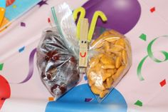 I keep our use of plastic bags to a bare minimum-- it is so easy, cheap, and environmentally-friendlier to use containers for snacks and lunch, however if you are going to use plastic bags for giving away snacks or treats at a party, this is a really cute way to do it.  http://enchantedmommy.com/awesome-3rd-birthday-cake/