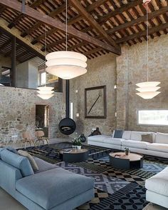 This interior is an excellent set of two styles, rustic and modern minimalist style. Brick wall, and details such as the ceiling beams, fireplaces, picture frame on the wall, give warmth to this area and will certainly, in the cold winter months heat your soul.