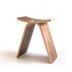 The bent plywood Interlochen Stool is sure to look amazing in any mid century modern home. It's walnut grain beautifully contrasts with the birch layers to create a fabulously modern seat. The two pieces easily slide apart to make it easy to store when you need a bit more space. It is the perfect stool in small spaces like entryways, in a bedroom to rest and take off your shoes, or in your living room when versatility is key.  DETAILS + Design, lamination, molding, finish, and assembly by…