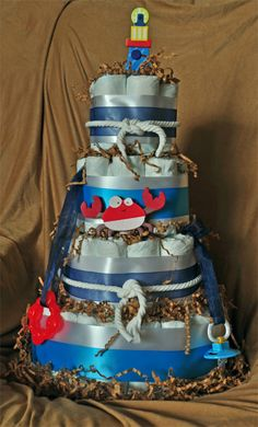 Nautical diper cake center piece....Use other tones of blues and white dipers. NOT include the lace!!!! LOVE the rope!
