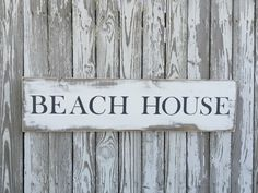 A personal favorite from my Etsy shop https://www.etsy.com/listing/399800495/beach-house-sign-70-color-options-wood