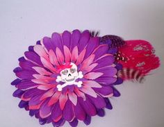 A personal favorite from my Etsy shop https://www.etsy.com/listing/226701811/handmade-flower-and-feather-hair-clip