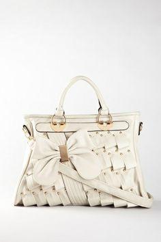 Beautiful woven handbag with bow.