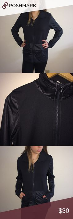"""Under Armour Women's Black Zip Up Excellent, very lightly used condition. Two front pockets. The Sleeves, front pockets, and zip up high neck all have the same windbreaker type of material. The body is more of a stretchy material. The Under Armour logo is located on the outside of the zip up neck. The care tag has been cut out. This belonged to my friend. For reference, my model is 5 feet 9"""" tall and 120 pounds, and this jacket is big on her. AG Under Armour Jackets & Coats"""