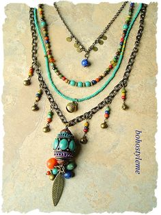 Boho gypsy style makes this long, multi strand, bohemian necklace perfect for today's creative fashion. This necklace includes a stunning barrel pendant dripping with sodalite, orange quartzite, Imperial jasper and charms. Colorful Indonesian seed beads, Czech glass and antique brass