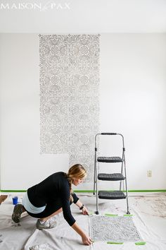 tip: wipe your wall stencil on your drop cloth in between placements to avoid smearing
