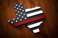 This handcrafted Thin Red Line Texas Firefighter wood flag is a symbol used to show respect for firefighters injured and killed in the line of duty.—made in the USA.