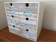 Ikea moppe drawers decorated with rough wood decoupage and metal label holders