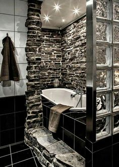 Love the stone work around the tub