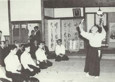 O Sensei teaching with Saotome Shihan sitting third person from the left.