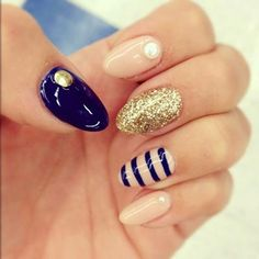 One nail with stripes #nailart #nails #womentriangle