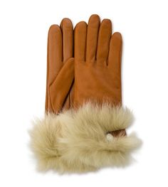 As luxe as can be, this glove features Toscana fur and Swarovski® crystal detailing. Touchscreen-friendly fingertips prevent cold hands when sending texts or snapping photos.