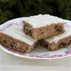 """Applesauce Bars     Moist and spicy bar cookies with frosting. An easy and quick after school snack. Also goes great at carry-ins and bake sales. You can also just sprinkle with confectioners sugar instead of frosting."""""""