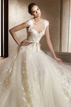 Ellie Saab. This website you can purchase it -> http://www.weddingveil-shop.com/princess-sweetheart-cap-tulle-lace-court-wedding-dress-style-aglaya-g11134