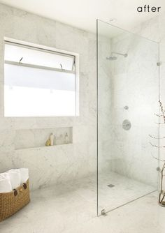 Walk-in standing shower with glass wall and no door. No ledge. Floor is continuous. 10 Walk-In Shower Ideas That Wow - Home Decorating Inspiration: