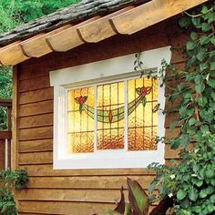 Swap out plain plate glass for something more romantic. Amber-colored glazing casts a warm glow, turning this lighted outbuilding into a sort of lantern. | Photo: Norm Plate | thisoldhouse.com