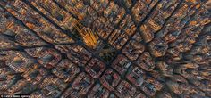 This perfectly ordered city is Barcelona in Spain - captured in the middle is the famous S...