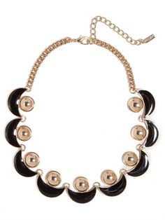 This bewitching collar is pure vintage glam, with its classic black enamel details and decidedly deco crescent motif.