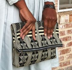 Kente foldover clutch by Suakoko Betty