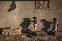 The shadows of children cast on the wall of their home in the Nile Delta town of Behira, Cairo, Egypt, May 6. (Mosa'ab Elshamy/Associated Press)