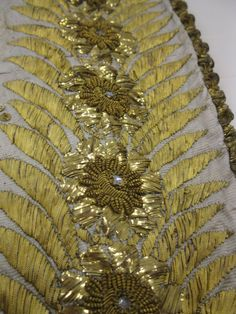Gold embroidery, dress detail. Close up. 1810