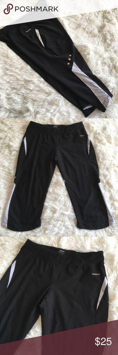 Large Reebok Capri Workout Leggings Excellent condition!  Cute gold details.  Capri length.  No flaws! Reebok Pants Leggings