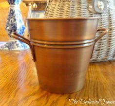Pretty little pail from Home Goods.  http://thededicatedhouse.blogspot.com/2013/05/my-little-shopping-spree.html