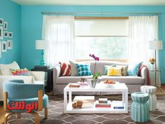 Love the turquoise walls, white couches and colorful pillows.