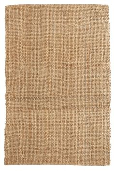 Hemp braided rug. Calypso Home's neutral and affordable rug works well with colorful accents and patterns in the room.