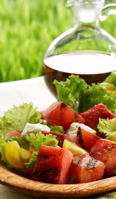 Grilled Watermelon Salad - Sample watermelon's savory side with this delicious spin on a summer salad—with greens, cherry tomatoes and goat cheese.