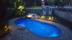 "As night rolls in, it seems only logical to feature another Leisure Pools ""Riviera"" fiberglass swimming pool - night version (courtesy of Bloom Field Landscape & Design.) Let us know when you're ready for your life of leisure."