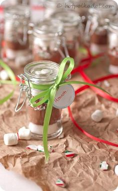 Individual peppermint hot chocolate mixes via @Lindsey {Hot Polka Dot}. (in wedding favor jars